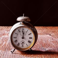 old alarm clock on a rustic wooden table stock photo (c) nito (#5563711) | Stockfresh
