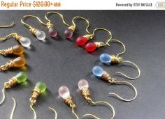 SUMMER SALE Seven Pair of Teardrop Earrings for the Price of Six - Wire Wrapped Clouded Glass Earrings in Gold. Handmade Jewelry. by TheTeardropShop from The Teardrop Shop. Find it now at http://ift.tt/TuwgMj!