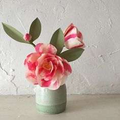 A little color on the rainiest of days. Camellia a la @thegreenvase, pottery by @suzylaz  #paperflowers