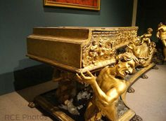Michele Todini's gilded Italian HARPSICHORD, circa 1670. Decorated with a frieze depicting the triumph of Galatea and supported by 3 tritons. Located at the Metropolitan Museum of Art, NYC.