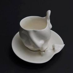Ceramic kiss cup and saucer... oh my!