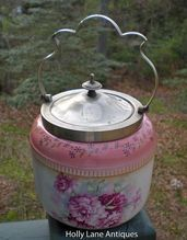 ANTIQUE ENGLISH BISCUIT JAR! -    Very Special Antique Devon Ware Biscuit Jar -    S Fielding & Co    A Wonderful Floral Pattern In Shades Of Rose On A Cream Background With Gold Accents -    A CHARMING COMBINATION !    The back stamp is shown and dates it to c1891-1921.  $128.00