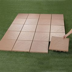 """Create an instant patio-on any grass, dirt or sand surface with our set of 20 Patio Tiles. They install in seconds for an impromptu barbecue, yet can be easily removed for a quick game of touch football.  • set of 20 ultra-lightweight tile set • covers a total of 35½"""" sq. feet. • measure: 16"""" square x 1""""H, each • weather-resistant and low-maintenance durable polypropylene • spiked bottoms that dig into ground for stability • hose clean &#82..."""