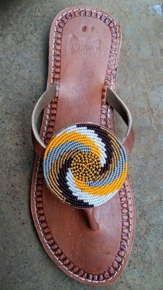 Maasai sandals / tribal sandals / beaded sandals / leather sandals – ETABLISSEMENT ALADIAH Maasai sandals / tribal sandals / beaded sandals / leather sandals pendo maasai sandals / tribal sandals / beaded sandals by afribead Beaded Shoes, Beaded Sandals, Beaded Jewelry, Boho Sandals, Cute Sandals, Flip Flop Sandals, Summer Sandals, Flip Flops, Summer Shoes