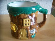 Disney Winnie the Pooh and Friends Tree Stump Coffee Mug. Has Pooh Bear, Piglet, Eeyore and Tigger all hanging out the windows at Piglet's house. Winnie The Pooh Friends, Disney Winnie The Pooh, Eeyore, Tigger, Pooh Bear, Tree Stump, Coffee Mugs, Objects, Tableware