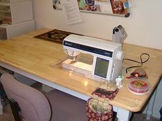 Install large sewing table (with drawers underneath).