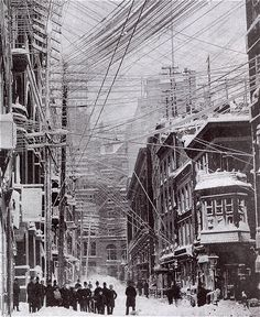 NYC in The Great Blizzard of 1888. Look at those powerlines! It's every angle created known to geometry.
