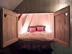 Bed hidden in an alcove. Love the heart cutouts in the doors! | 38 Smart Small Bedroom Designs with Hidden Bed | Tiny Homes