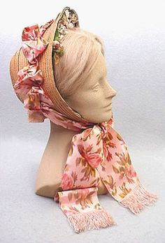 Ooh, I want this bonnet! Note the wide ribbon and the flowers nestled around her face - both very typical of the war era bonnets.