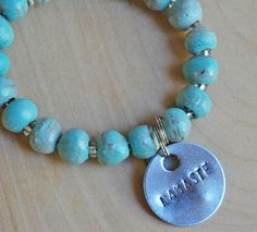 Simbi clay bead bracelet : seafoam – Walden Surfboards Walden Surfboards, Clay Beads, Sea Foam, Surf Shop, Silver Charms, Hand Stamped, Turquoise Necklace, Beaded Bracelets, Charmed