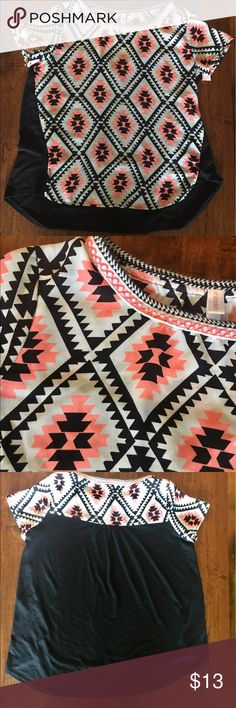 Bright peach and black top In excellent condition bright peach color and black cat could be one dressy or casual . The front is 100% polyester the back of the shirt is 65% polyester 35% rayon feels like a cotton material Xhilaration Tops Blouses