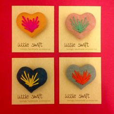 Embroidered folk heart brooches