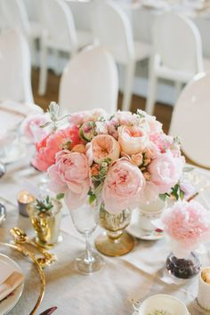 Lush mixed pink centerpiece in a gold vase..  Read more - http://www.stylemepretty.com/2013/11/14/toronto-wedding-at-the-burroughs-building-from-mango-studios/