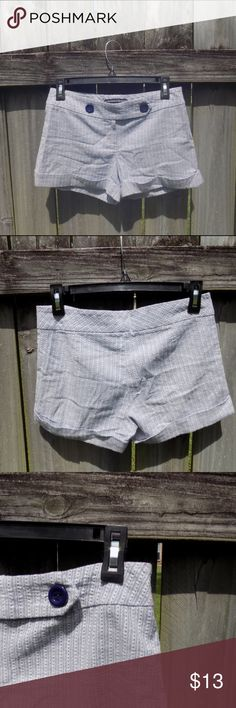 Blue and White Patterned Shorts The absolute cutest! The pattern is a gray-navy blue and white with a hint of sparkle. The bottoms are cuffed. The buttons are dark navy blue. The waist measures about 14 inches flat, and they are about 10.5 inches long. Dazz Fascinating Design Collection Shorts