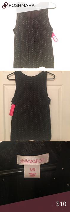 Black with white dots short sleeve blouse Brand new blouse size L, with tags ! Xhilaration Tops Blouses