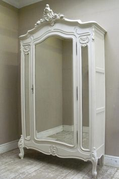 French Antique Rococo Style Armoire.