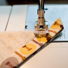 Canto mitrado, método com costura no bico.