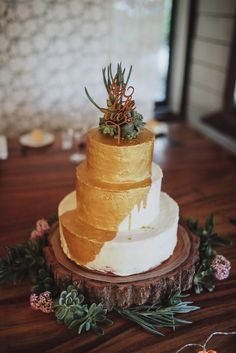 rustic gold drip wedding cake with succulents