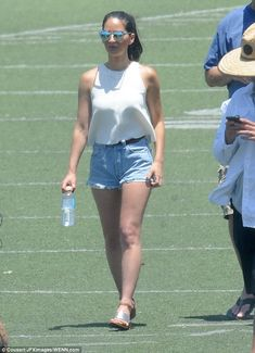 Smitten: Olivia Munn put on an extremely loved-up display with beau, Aaron Rodgers in Los Angeles on Saturday
