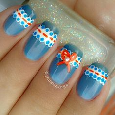 Paint your nails blue with a little bit of lace nail art design. The laces are painted in white polish with a little red ribbon tied around it and a white bead on top. Blue, there is more than what meet the eyes.