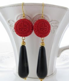Black onyx drop earrings with red carved cinnabar by Sofiasbijoux, £24.00