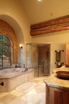 Large open bathroom in this log house. Replace that tub with a clawfoot bath.