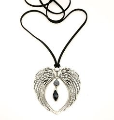 The Charmeine Necklace The Charmeine Necklace, named after 'The Angel Of Harmony', she is made out of natural black suede, with a large Tibetan Angel heart.
