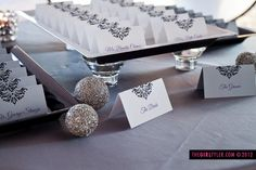 Tiered Place Card Display with Sparkly Accents  Shimmer place cards by The Girl Tyler www.thegirltyler.com   Styler Shoot by As You Wish Weddings and Events www.asyouwishva.com and The Girl Tyler Photography www.thegirltyler.com  #placecards #grayreception #damask #asyouwish