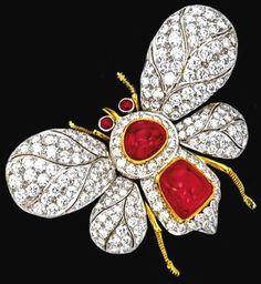 Ruby and diamond bee brooch.