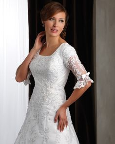 I love this dress! Love the beaded lace and the sleeves are so pretty.
