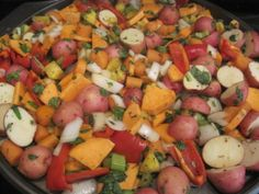 Roasted Veggies, tonight's combination includes red potatoes, sweet potatoes, onion, red peppers, celery, carrots, pineapple, chopped spinach, spices, and teriyaki sauce... Yummo!