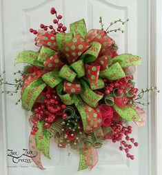 Curly-q method used to make this wreath with a HUGH bow placed in the center made of two styles of premium wired ribbon and red and green glitter Christmas Berry picks. Simple but just enough sparkle to hang on your door and welcome your guest for the holidays.