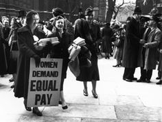 Women rallying for equal pay in London in 1954. Photo: Getty Images.