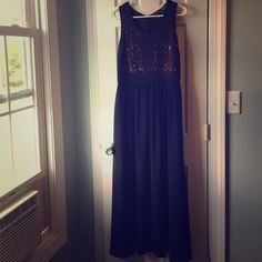 Long black dress Long black dress with cutouts on the chest so you can see the pink backing. Top of the back of the dress is sheer. Worn only once. Forever 21 Dresses
