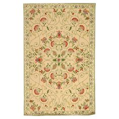Hand-hooked wool rug with a scrolling vine and floral motif.  Product: RugConstruction Material: 100% Wool
