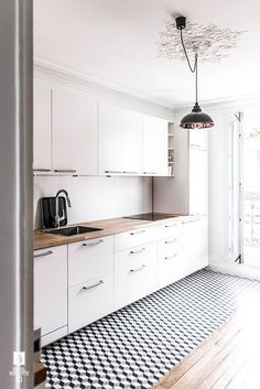 an airy Scandinavian kitchen with white cabinets, butcherblock countertops, a ge. an airy Scandinavian kitchen with white cabinets, butcherblock countertops, a geometric floor and p White Kitchen Cabinets, Kitchen Flooring, Kitchen Backsplash, Kitchen White, Backsplash Ideas, Tile Ideas, Kitchen Countertops, Oak Cabinets, Laminate Countertops