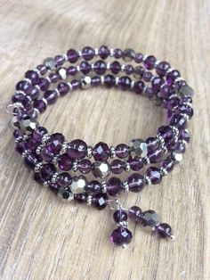 A personal favourite from my Etsy shop https://www.etsy.com/uk/listing/257854001/dark-purple-and-silver-beaded-memory