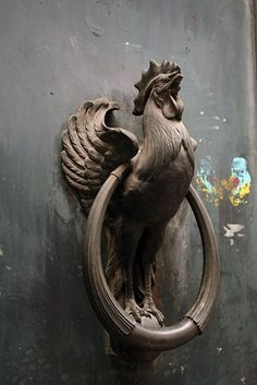 Rooster in Paris. Door knocker to old farm house!! awwwwwesome!!!!! (bottom of the round brass pull is uncovered so it will bang against the roosters feet!!