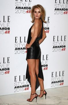 Rosie Huntington-Whiteley was in an awkward dilemma involving her personal trainer James Duigan - who transformed her body from waif-like English rose to Amazonian beauty - and gym instructor brother Toby
