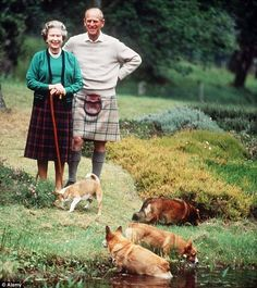 Queen and corgis and that guy in the skirt is her husband.
