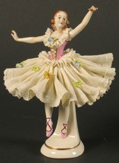 DRESDEN LACE BALlERINA Dresden lace ballerina, flaring white lace tutu with floral decoration. Marked: Crown F Germany