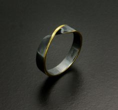 Gold Keum Boo silver ring of a Möbius loop by KAZNESQ on Etsy, $180.00
