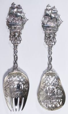 """Lot 120: George Roth & Co Hanau (Germany) Silver Utensils; c.1910, including an oversized fork and spoon having ornate designs on the pierced bowl and handle; marked on bowl with """"Germany"""", """"Georg Roth"""" and """"sailing ship"""""""