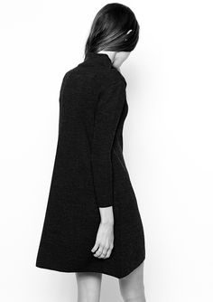 Black knitted swing dress with high neck; minimal fashion // ASOS
