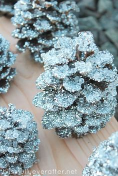 DIY Knockoff Pottery Barn Glitter & Snow Pinecones with Glitter {color of your choice… like silver}, crystal color filler, spray adhesive, jute twine, hot glue gun. ·