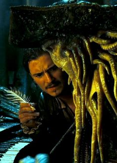 Davy Jones sleeps whilst Will Turner attempts to steal the hidden key.