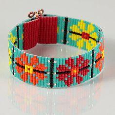 He encontrado este interesante anuncio de Etsy en https://www.etsy.com/es/listing/199901638/guatemalan-garden-bead-loom-bracelet