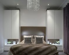 Bespoke British Kitchens, Wardrobes + Furniture - Innovative Contemporary Design from Roundhouse   Interesting way of placing wardrobes / side table around bed area