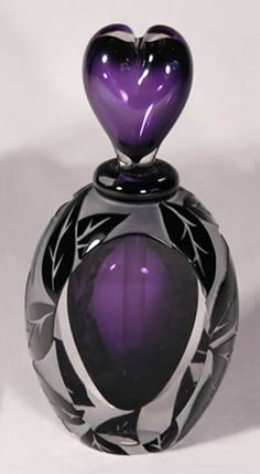 purple perfume bottle with heart shaped stopper