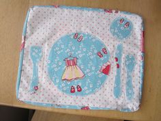 Montessori placemat for the play kitchen, made with Children at Play fabric